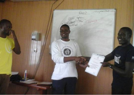 From the right to left (Mr. Aliyu of ISOTECH Research Consult, Dr. Amos Laar of HM2R, and Mr Ernest Amoah Ampah receiving his certificate