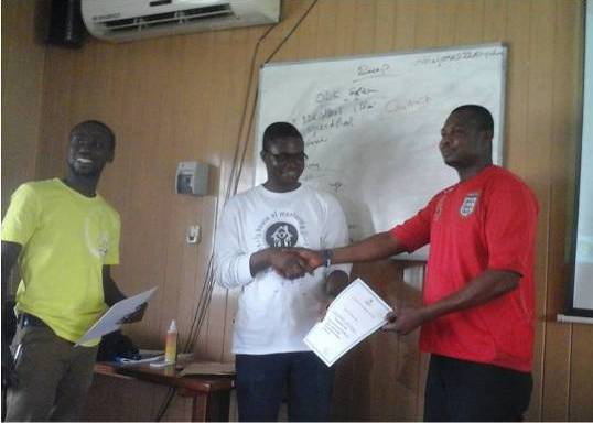 From the right to left (Mr. Aliyu of ISOTECH Research Consult, Dr. Amos Laar of HM2R, and Mr Solomon Tetteh, a trainee receiving his certificate)