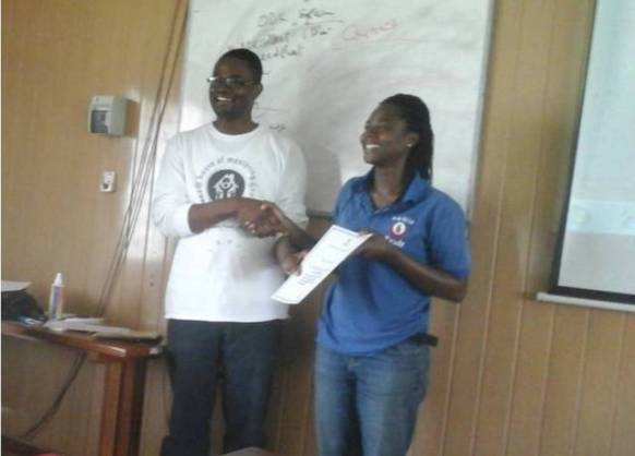 From the right to left (Mr. Aliyu of ISOTECH Research Consult, Dr. Amos Laar of HM2R, and Miss Angelina Andoh receiving her award